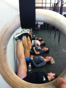 A group of Crossfit ladies stretching (and chatting)  after a WOD.